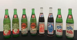 Lot of 8 Vintage Pepsi and 7-Up Bottles