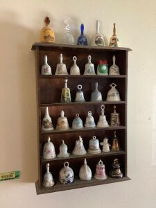 Wall shelf w/ bell collection, vases on dresser and Johnny Lightning car