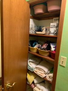 Linen closet full of towels, dishpans, stemware, hand soaps, man groomer and much more