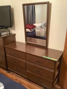 Dresser set on casters. Four drawer dresser measures 33.5 x 17 x 41 and six drawer dresser measures 51.5 x 17.5 x 68.  Mirror does remove