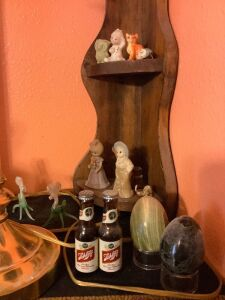 Ladder shelf w/ knick knacks, corner shelf and tchotchkes, table lamp, and other little pretties