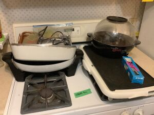 Kitchen utensils, silverware, hand towels, cookie sheets, wire racks, griddle, electric skillet and stir crazy popper