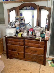 "Three drawer dresser w/ bifold mirror Measures 56""L x 18""W x 75""H. Mirror removes for moving No contents"