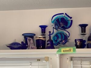More pretty blue glass including Fenton, S & P shakers, measuring cups, sea life, candle holders and more