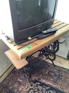 Domestic sewing machine base turned into a TV stand, Panasonic TV/VHS, GPX DVD player