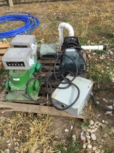 Group of 4 water meters and Leeson 3 hp, 1 phase motor with pump