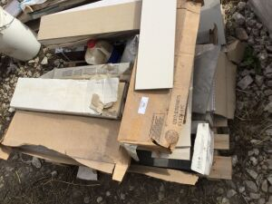 "A pallet of 6 1/2"" x 24"" tiles. Off-white and beige."