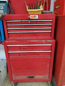 Rolling tool chest with eight drawers, lift top, and storage underneath.