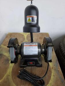 Central machinery 6-in bench grinder with light.