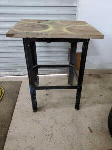 Small adjustable table for mounting power equipment.