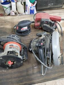 Craftsman router, skill saw circular saw, skill saw sander, and drill master palm sander.