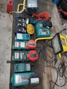Makita battery chargers, some batteries, Makita flashlight that needs a battery, and two work lights. All untested.