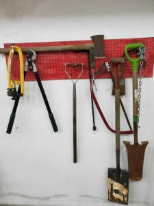 Grouping of lawn and garden tools. Includes fertilizer spreader, shovels, and more.