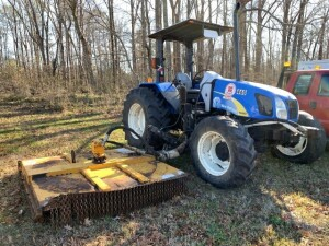 New Holland T5050 Tractor with side mower