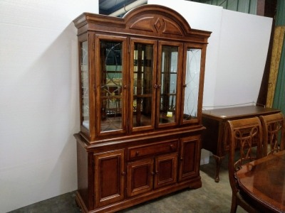 VERY NICE FORMAL CHINA CABINET, HAS LOTS OF STORAGE AND IS LIGHTED, COMES WITH GLASS SHELVING FOR INTERIOR, VERY BEAUTIFULLY MADE