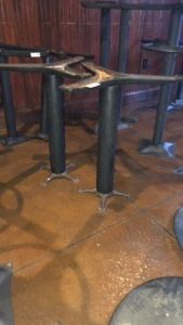(2) pedestal table legs with 2 tabletops; tabletops were not available for photograph; Tabletops will be there on pick-up day.