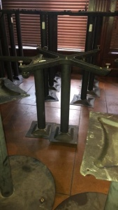 (2) pedestal table legs with 2 tabletops; tabletops were not available for photograph.  Tabletops will be there for pick-up day.
