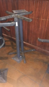 (2) pedestal table legs with 2 tabletops; tabletops were not available for photograph.  Tabletops will be there for pick-up
