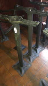 (2) pedestal table legs with 1 tabletop; tabletop was not available for photograph.  Tabletops will be there on pick-up day.