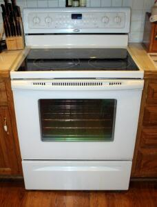 "Whirlpool Electric Smooth Surface Four Burner Range, Model GFE461LVT, Off White, 37"" x 30"" x 27.5"", Bidder Responsible For Proper Removal"