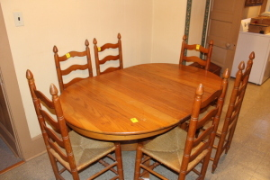 Table with 2 leaves and 6 cane bottom ladder back chairs