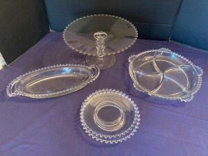 Candlewick cake stand, relish tray, double-handled oval relish tray and two appetizer plates