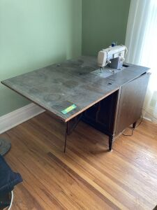 Sewing table measures 45 x 32 x 29 with a vintage Sears Kenmore machine and remaining contents