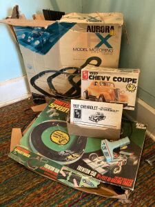 Parts for at least two slot car tracks and an Ertl AMT 1937 Chevy Coupe model kit - intact