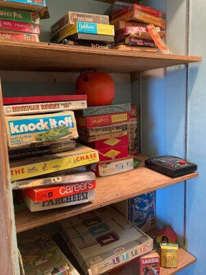 Closet full of puzzles, board games, Lite Brite and more
