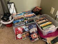 DVDs, VHSs (several Disney) and playing cards