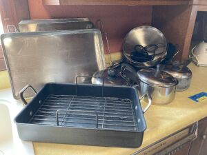 Calphalon roaster, silverware, baking pans, Oster blender, grilling tools, Taste of Home cookbook series and more