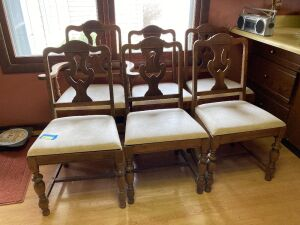 Six padded dining chairs-one is a captains chair - seats measure 19 inches across