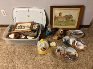 Tote of assorted picture frames, Goebel sleeping pigs figurine, two decanters (one broken both unsealed), vintage John Deere hat, farm themed collectors plates