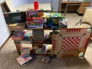 Hours of fun in this lot! GI Joe carrying case, carom board, vintage Barbie dolls, board games (vintage and newer), Golden Books, picture books, poker chips, partial Playskool wood letter block and more. Shelf included!