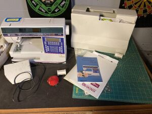 Husqvarna Lily 530 sewing machine - also cutting mat and any other contents remaining on desk