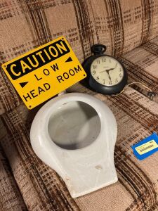 Spartus electric clock that looks like a stop watch, enamel bed pan and a caution low head room sign