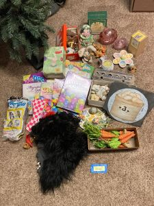 Holiday items including a 4 foot prelit Christmas tree, Halloween masks and lots of Easter decor including two bunnies on nests