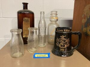 Milk bottles and others: Northwood Dairy, Cedar Rapids, H. Rosenthal, Inc., Chicago, United Dairies, Cedar Rapids, Mahaska bottle, large elixir bottle and a Parsons College 1955 stein