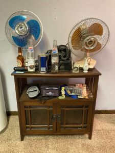 Small entertainment cabinet (30x15x30) and all contents seen in the photos: fans, vintage car phones, desk supplies, Pepsi bottles and more
