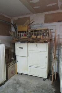 "Contents of corner, wooden cabinet 49"" W x 26"" D x 55"" T"