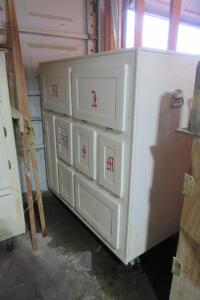 "Cabinet and contents, 49 1/2"" W x 25 1/2"" D x 54"" T"