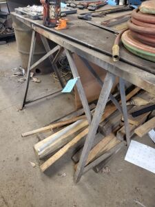 Lot of 2 sawhorses, steel slab on top and wood underneath