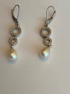 14 k white gold pearl and diamond earrings