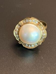 14 karat gold diamond and pearl ring