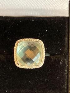 14 karat white gold diamond and light green stone ring