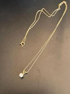 14 K yellow gold chain with diamond pendent