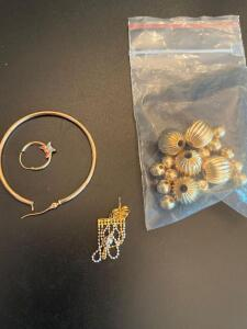 Several pieces of gold scrap jewelry