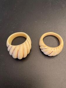 Two ivory colored rings with 14k gold trim