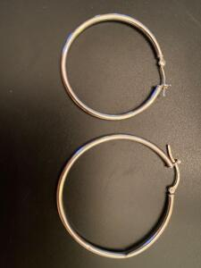 Two 14 karat gold hoop earrings, these are not a pair they are two different sizes