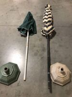 TWO OUTDOOR PATIO UMBRELLAS WITH BASES (4)